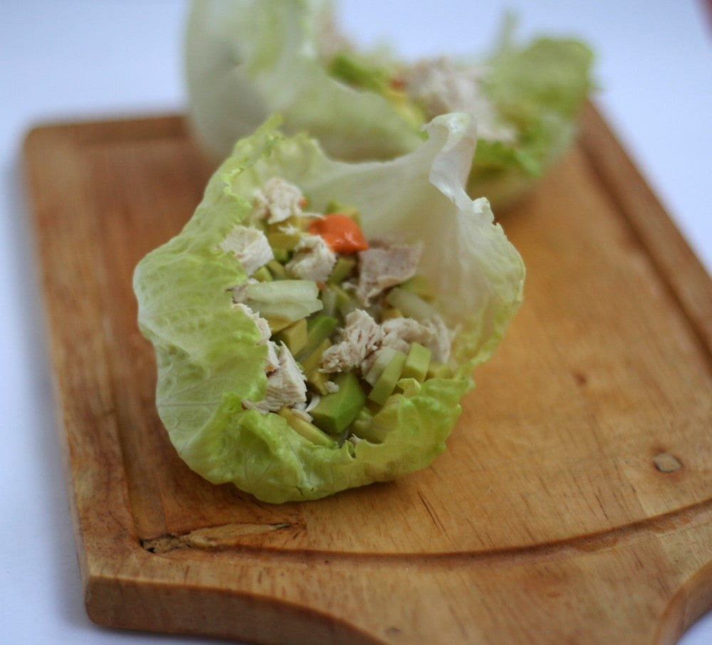 chicken lettuce snack wraps with chicken, avocado, lime juice and sauce